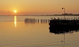 Solopgang over Omø Havn